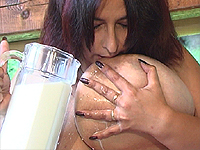 Cold milk on her hard boobs.